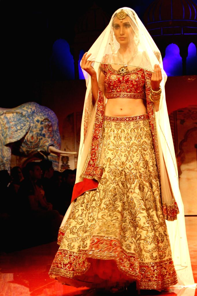 A Model showcasing designer Suneet Verma's creation during `BMW India Bridal Fashion Week 2014`, in New Delhi on August 09,2014.