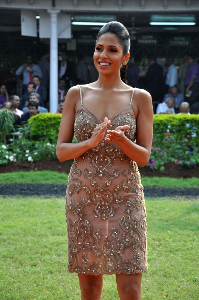 A Model showcasing fashion designer Rocky S collections during the fashion show at McDowell Signature Premium Indian Derby 2013 in Mahalaxmi Race Course, Mumbai on Sunday, February 3rd, evening.