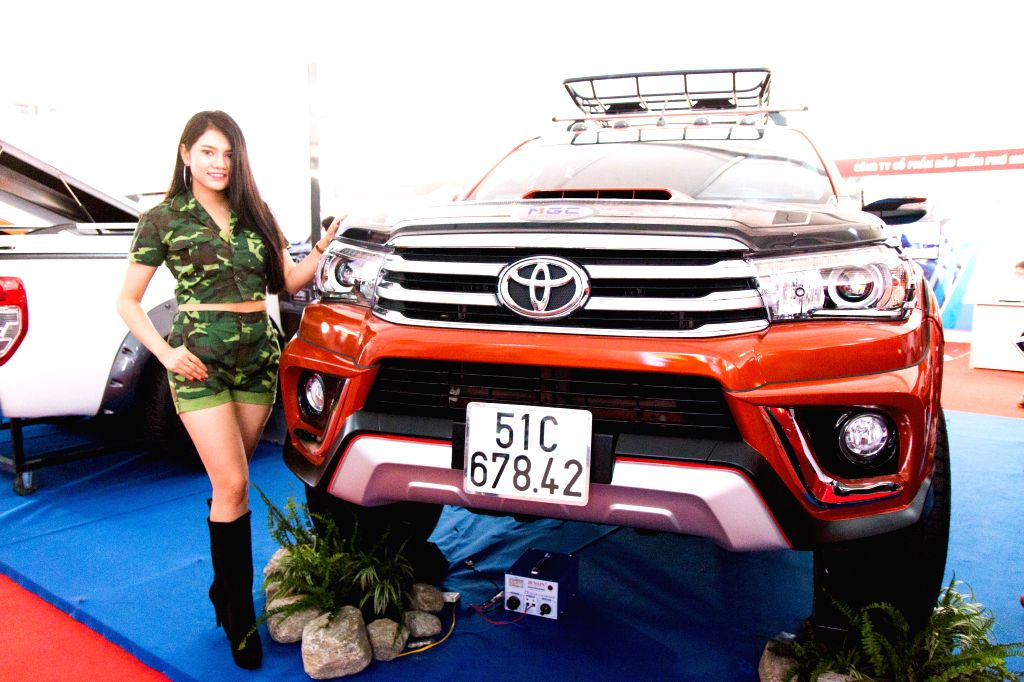 A model stands next to a car during the Vietnam International Motor Show 2016 in Ho Chi Minh city, Vietnam, Oct. 29, 2016. The Vietnam International Motor ...