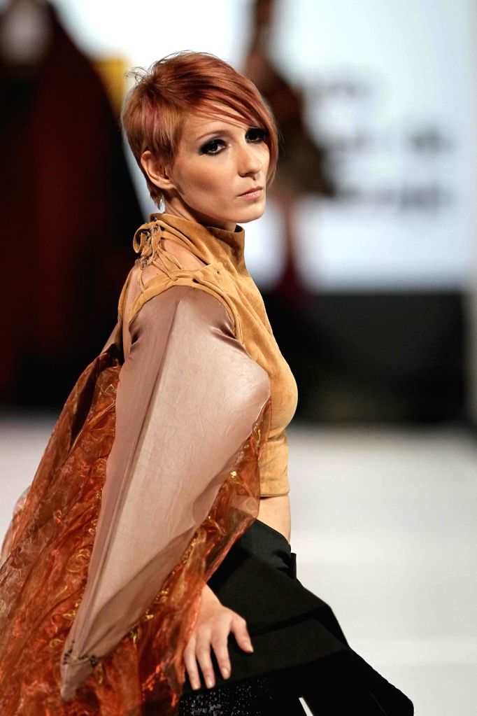 A model takes the catwalk at the 11th edition of the Fashion Week in San Jose, Costa Rica, 09 August 2013. The event, which takes place until next 11 August, shows the most outstanding in fashion, ...