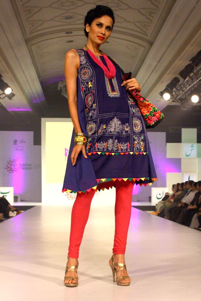 A model walk the ramp during a fashion show ahead of Aalishan Pakistan - a four-day-long lifestyle exposition organised by the Federation of Indian Chambers of Commerce and Industry (FICCI) and Trade