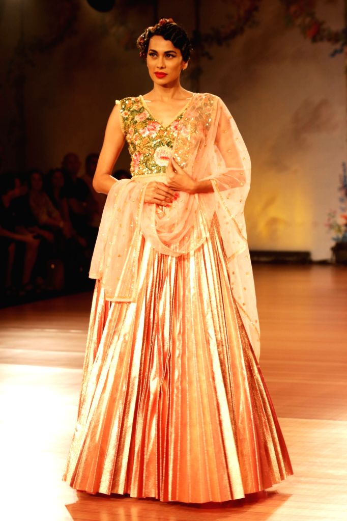 A model walk the ramp for designer Pallavi Jaikishan at India Couture Week 2018 in New Delhi on July 26, 2018.