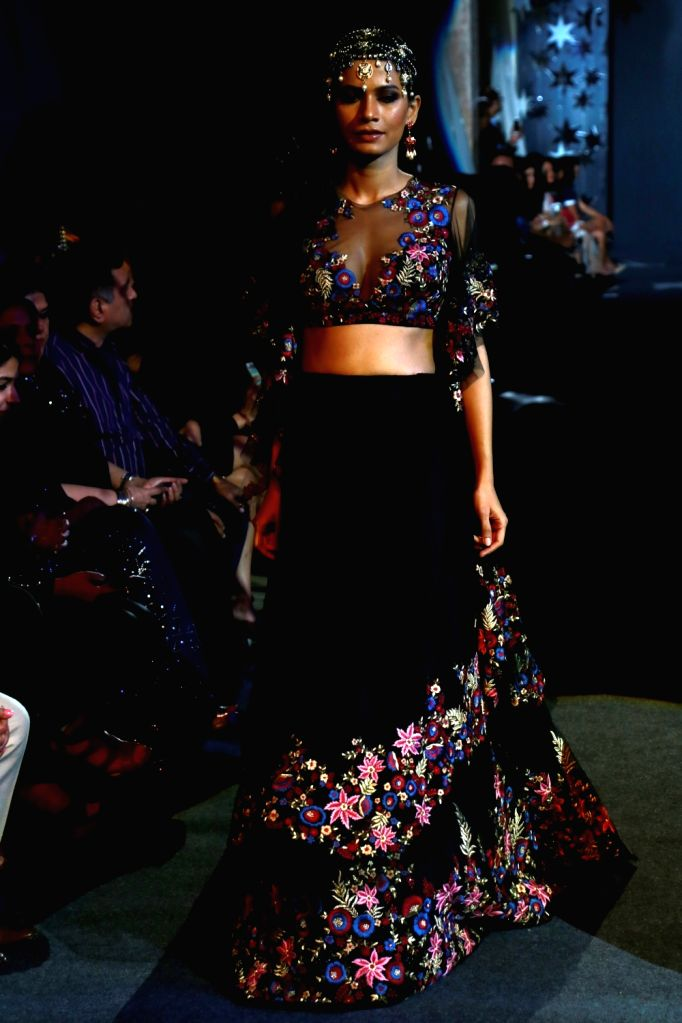 A model walk the ramp for designer Suneet Varma showcased his couture collection , in New Delhi on April 29,2017.