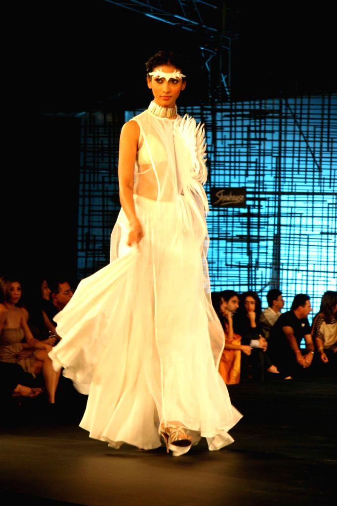 A model walking at designer Wendell Rocdericks Show at Chivas Tour at Grand Hyatt.