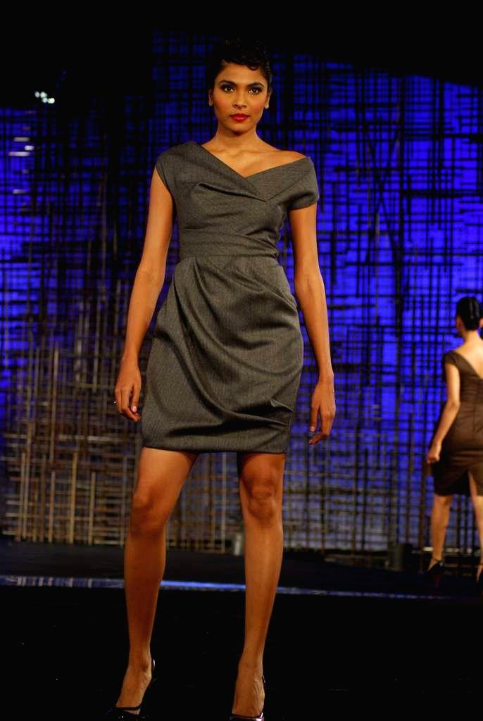 A model walking at designers Gauri, Nainika and JJ Valaya Show at Chivas Tour at Grand Hyatt.