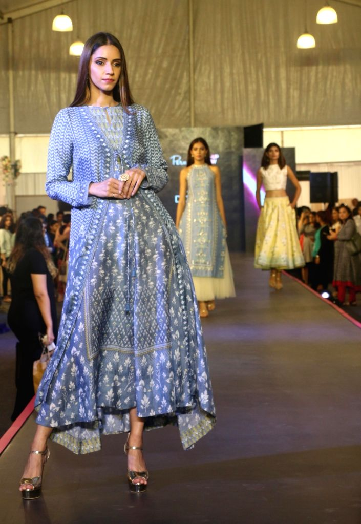 A model walks on the ramp at Pernia Pop Up Fashion Show 2018, in Mumbai on March 30, 2018.