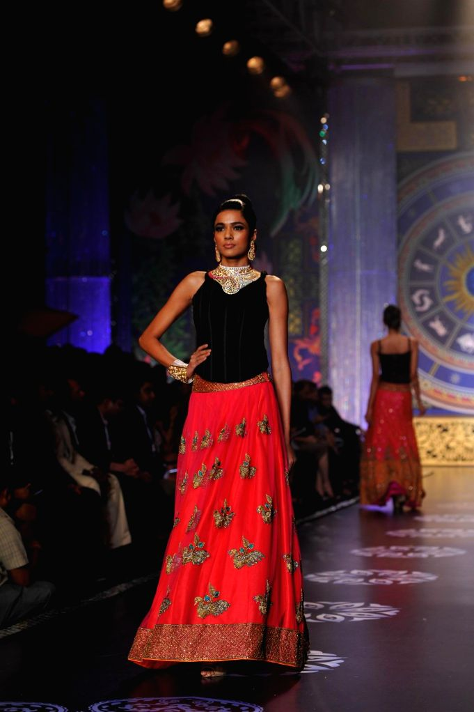 A model walks on the ramp during the grand finale of India International Jewellery Week (IIJW) in Mumbai on July 17, 2014.