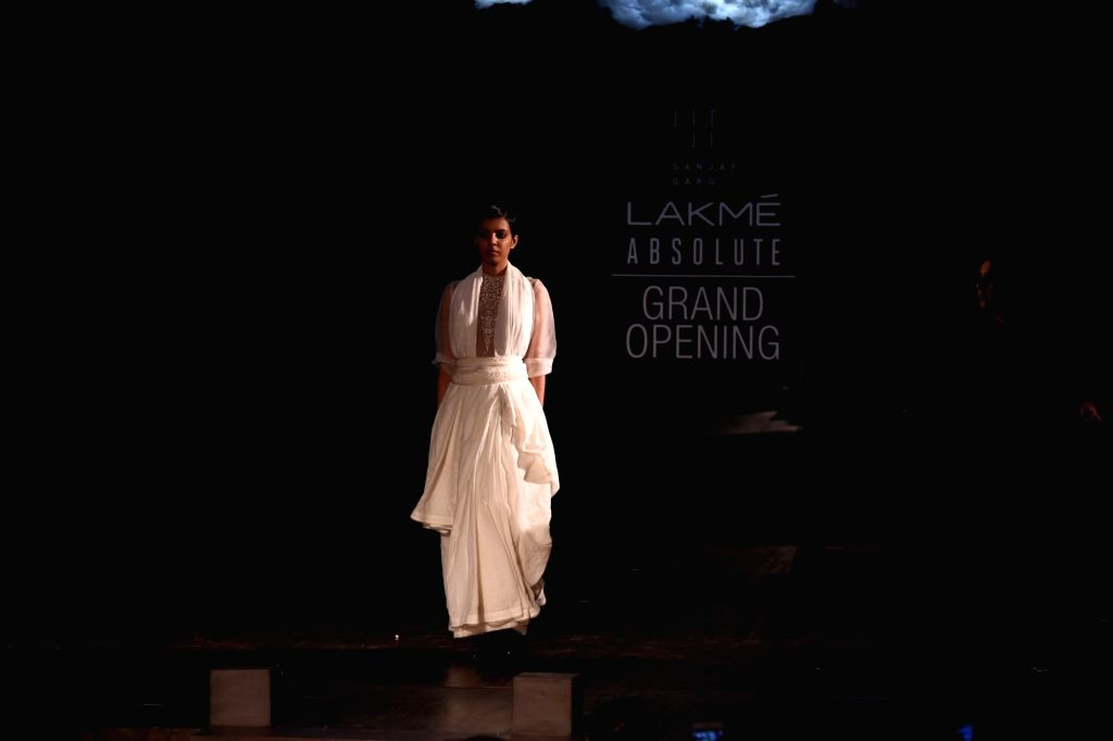 A model walks on the ramp during the opening show of Lakme Fashion Week Winter/Festive 2017 for Designer Sanjay Garg, in Mumbai on Aug 16, 2017 .