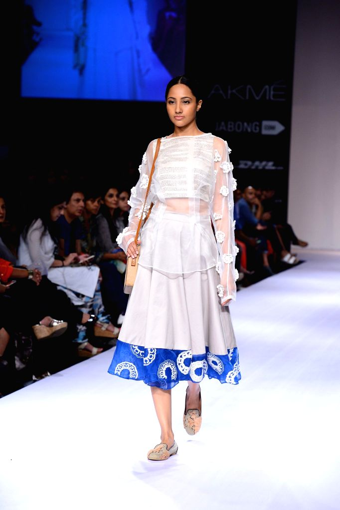 A model walks on the ramp for designer Archana Rao during the Lakme Fashion Week (LFW) Winter/ Festive 2014 in Mumbai, on Aug. 19, 2014.