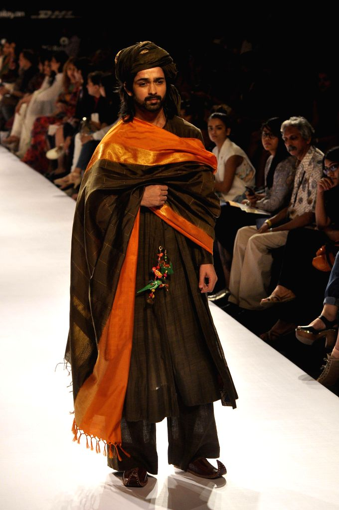 A model walks on the ramp for designer Gaurang Shah during the Lakme Fashion Week (LFW) Winter/ Festive 2014, in Mumbai, on Aug. 22, 2014.