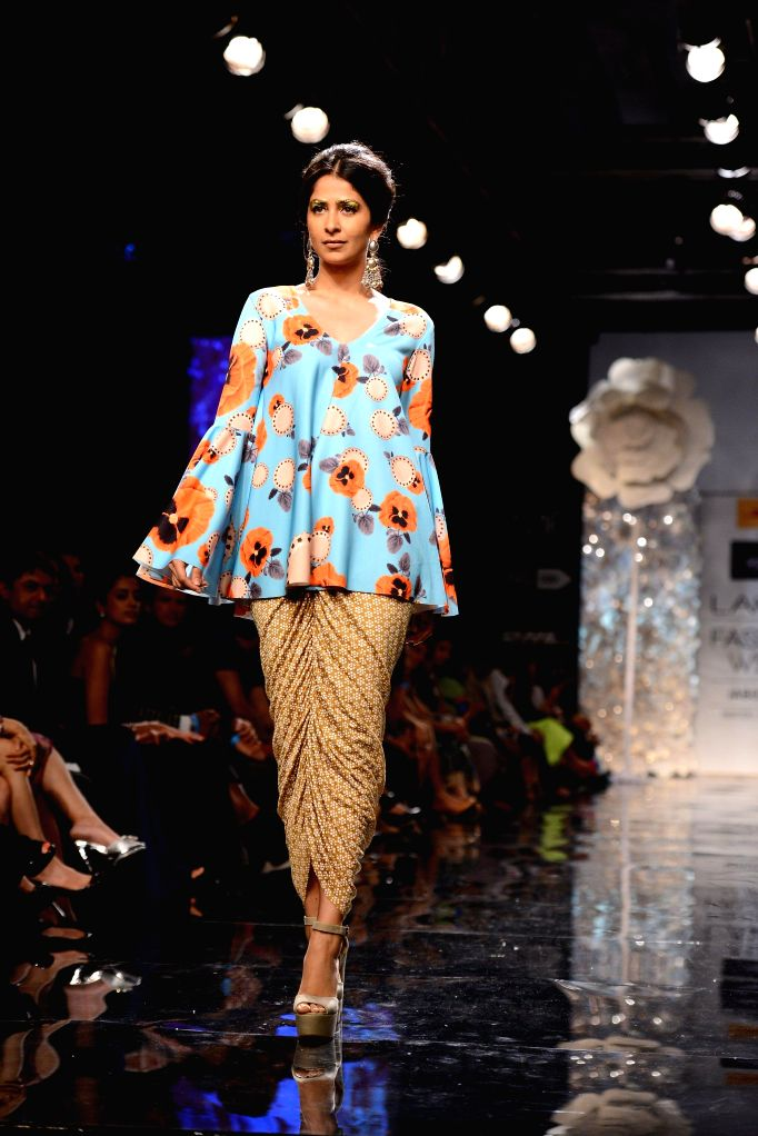 A model walks on the ramp for designer Masaba Gupta during the Lakme Fashion Week (LFW) Winter/ Festive 2014 in Mumbai, on Aug. 20, 2014.