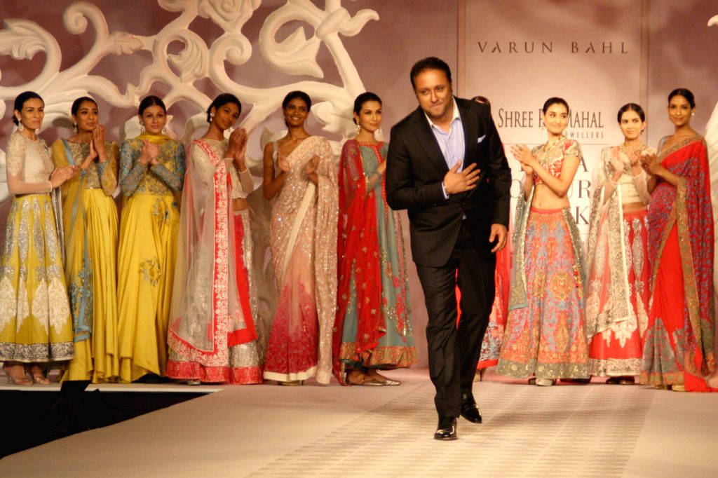 A model walks on the ramp for designer Varun Bahl`s show during India Couture Week 2014, in New Delhi on July 17, 2014.
