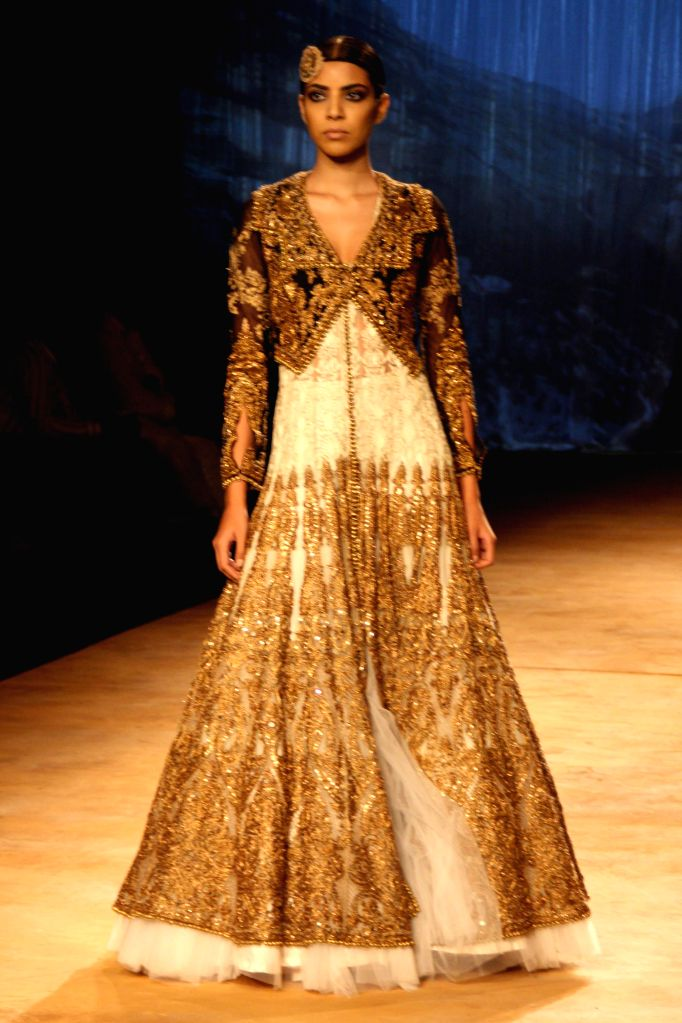 A model walks on the ramp for designers Rimple and Harpreet Narula`s show during the India Couture Week 2014, in New Delhi on July 20, 2014.