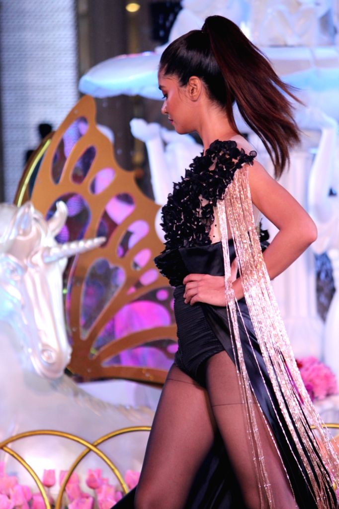 A model walks the ramp at a fashion show organsied to unveil the Spring Summer collection of Ritu Kumar, Satya Paul, Forever New and CoverStory in Mumbai on April 26, 2019. - Ritu Kumar