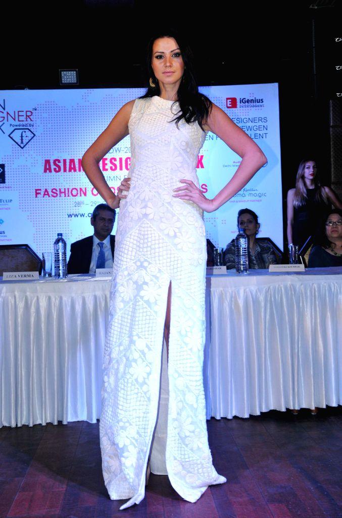A model walks the ramp at Asian Designer Week 2015 in New Delhi, on Oct 27, 2015.