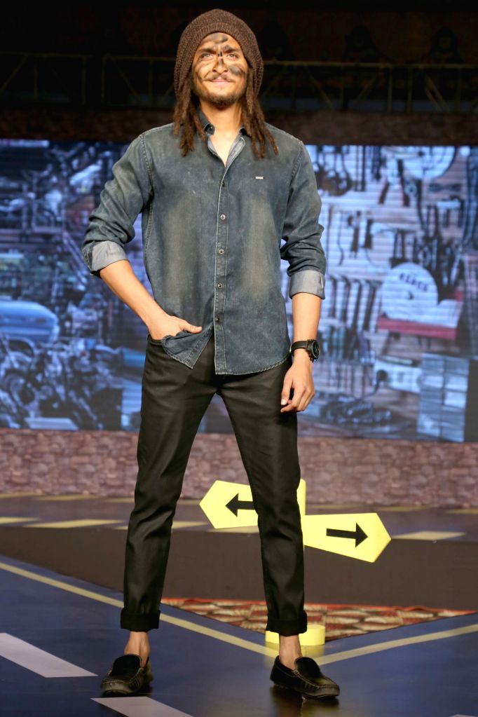 A model walks the ramp at the launch of ``VDot Roadies Collection`` in New Delhi Oct 16, 2015.