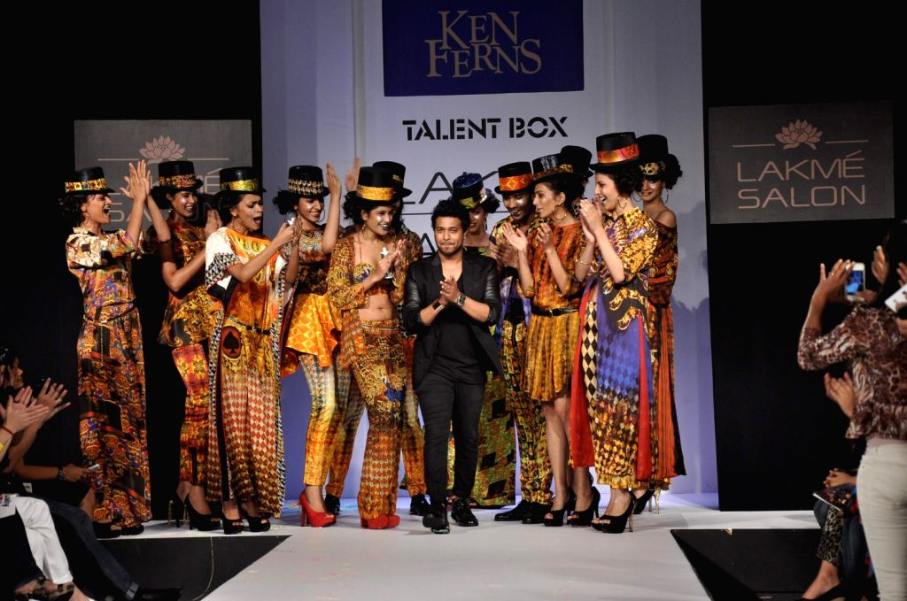 A model walks the ramp displaying an outfit by Indian designer Nikhil Thampi during the Lakme Fashion Week Summer/Resort 2013 Day 2, in Mumbai on March 23, 2013.