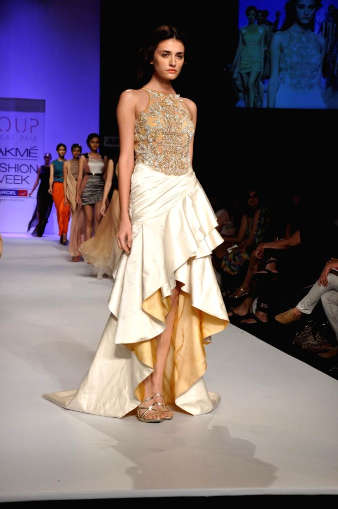 A model walks the ramp displaying an outfit by Indian designer Sougat Paul during the Lakme Fashion Week Summer/Resort 2013 Day 2, in Mumbai on March 23, 2013.