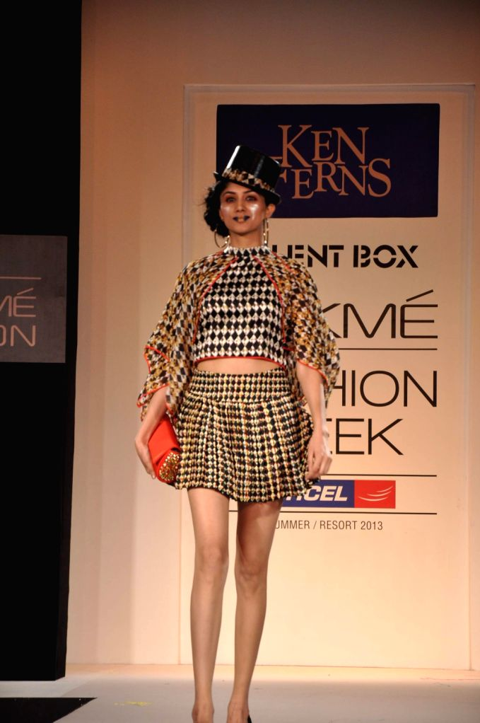 A model walks the ramp displaying an outfit by Indian designer Ken Ferns during the Lakme Fashion Week Summer/Resort 2013 Day 2, in Mumbai on March 23, 2013.