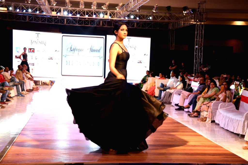 A model walks the ramp during a fashion show organised in Patna on Aug 10, 2018.