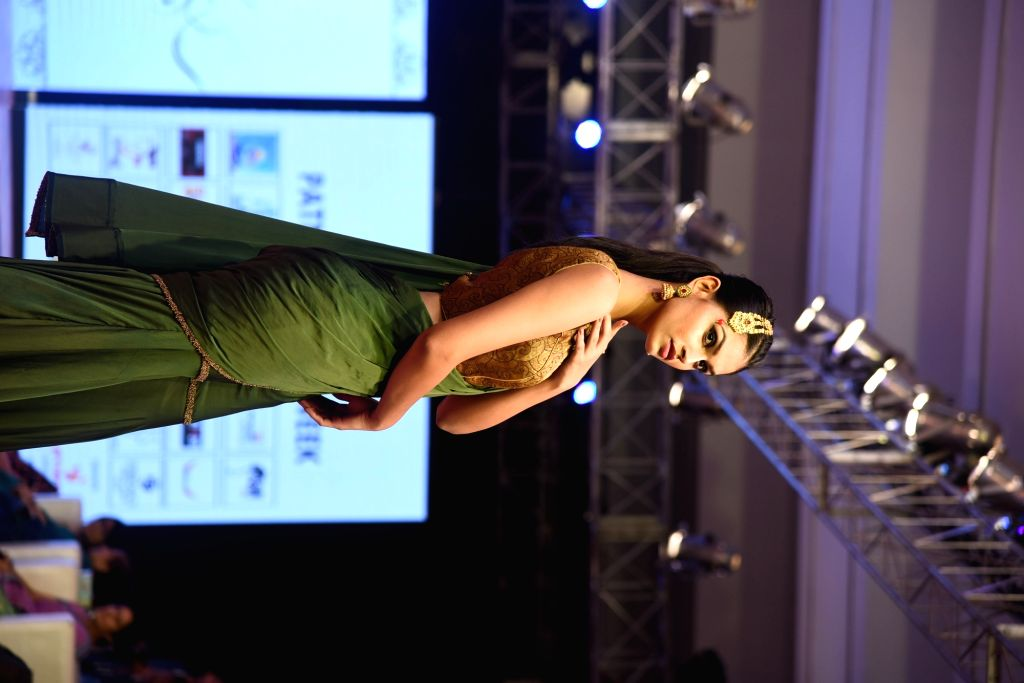 A model walks the ramp during a fashion show organised in Patna on Aug 11, 2018.
