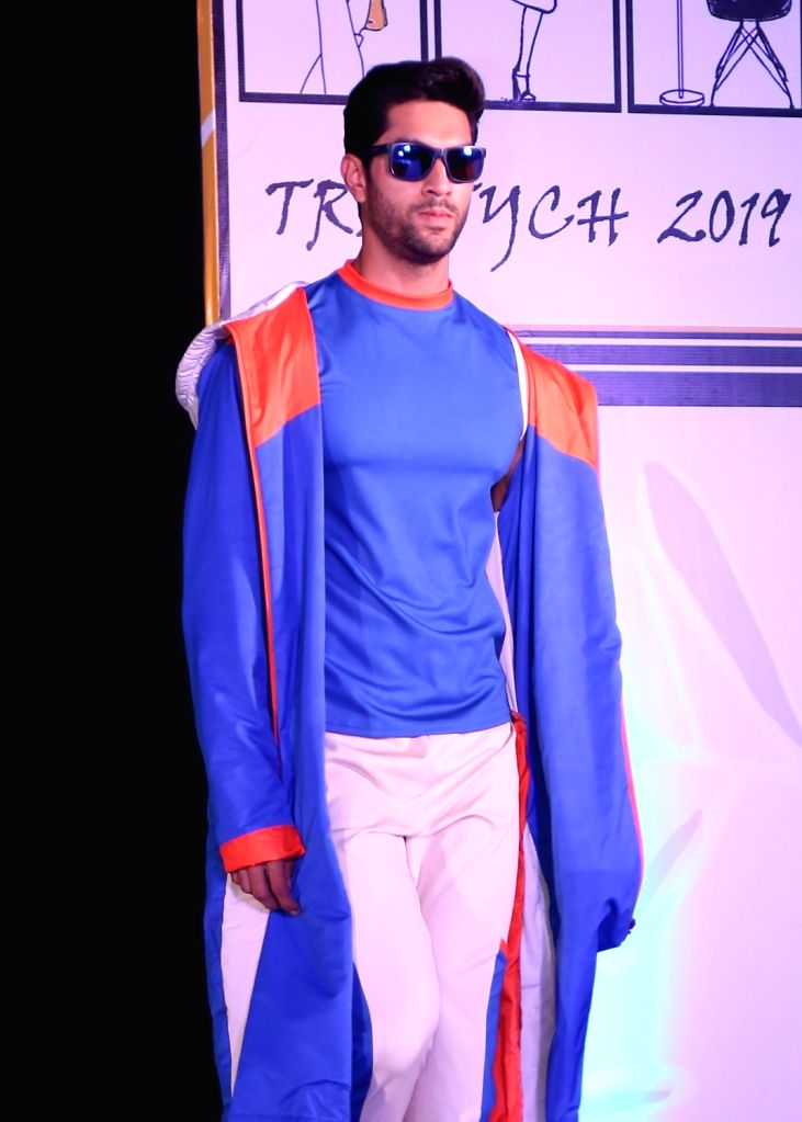 A model walks the ramp during a fashion show 'TRIPTYCH 2019' in New Delhi, on April 25, 2019.