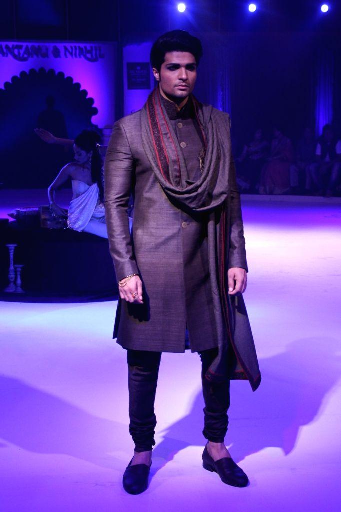 A model walks the ramp during a fashion show in Kolkata on Nov 15, 2015.