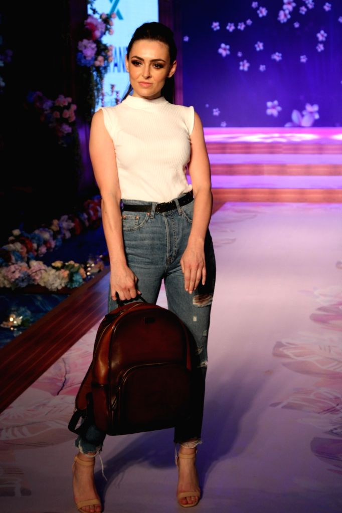 A model walks the ramp during a fashion show in Noida, on May 10, 2019.