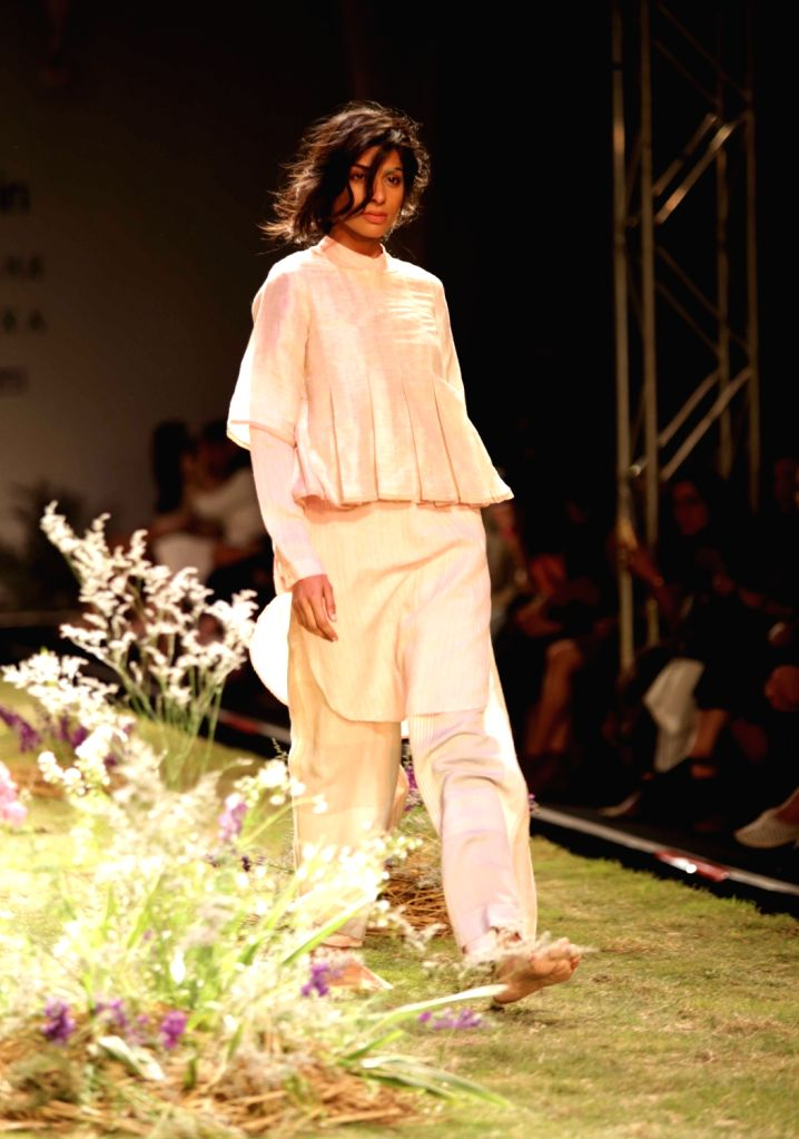 """A model walks the ramp during Amazon India Fashion Week - Autumn Winter's opening show """"The Handloom School"""", in New Delhi, on March 15, 2017."""