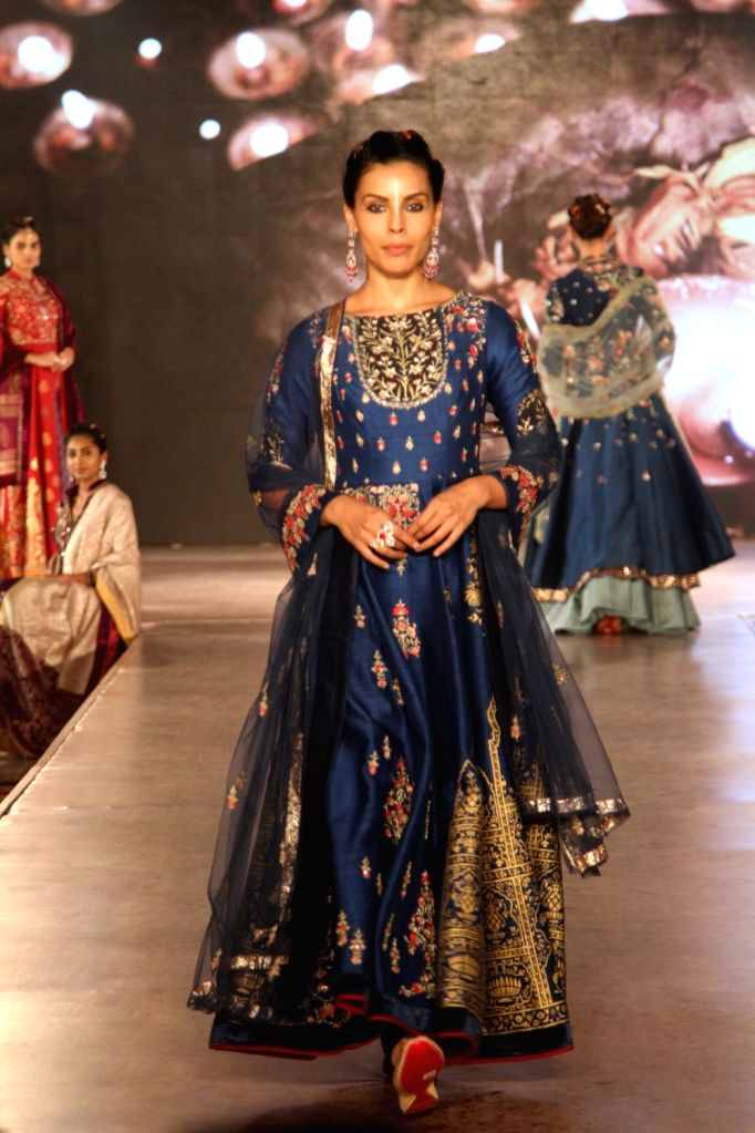 A model walks the ramp during Archana Astitwa Awards 2017 in Mumbai on March 7, 2017.