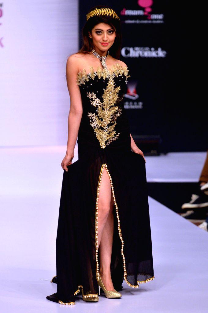 A model walks the ramp during Bangalore Fashion Week 2014, in Bangalore on Aug 8, 2014.