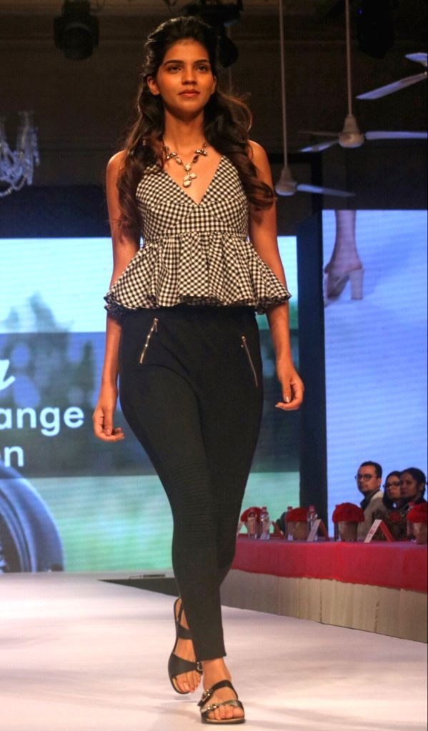 A model walks the ramp during Bata Fashion Show in New Delhi on May 2017.