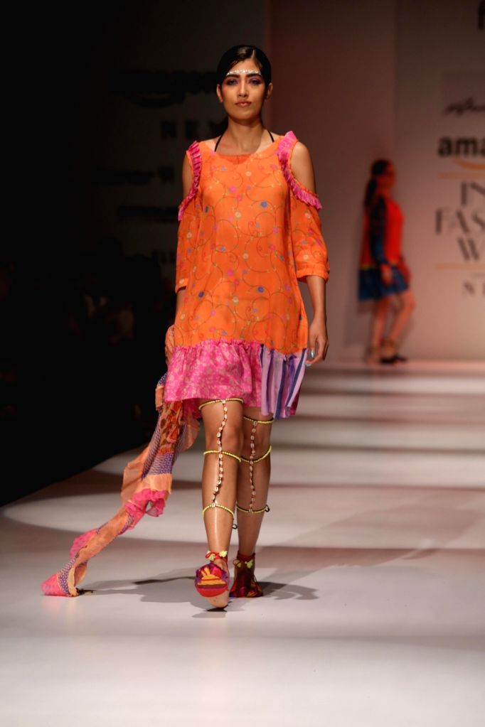 A model walks the ramp during designer Anupamma Dayal's show at Amazon India Fashion Week Summer Spring 2017 in New Delhi on Oct 11,2017.