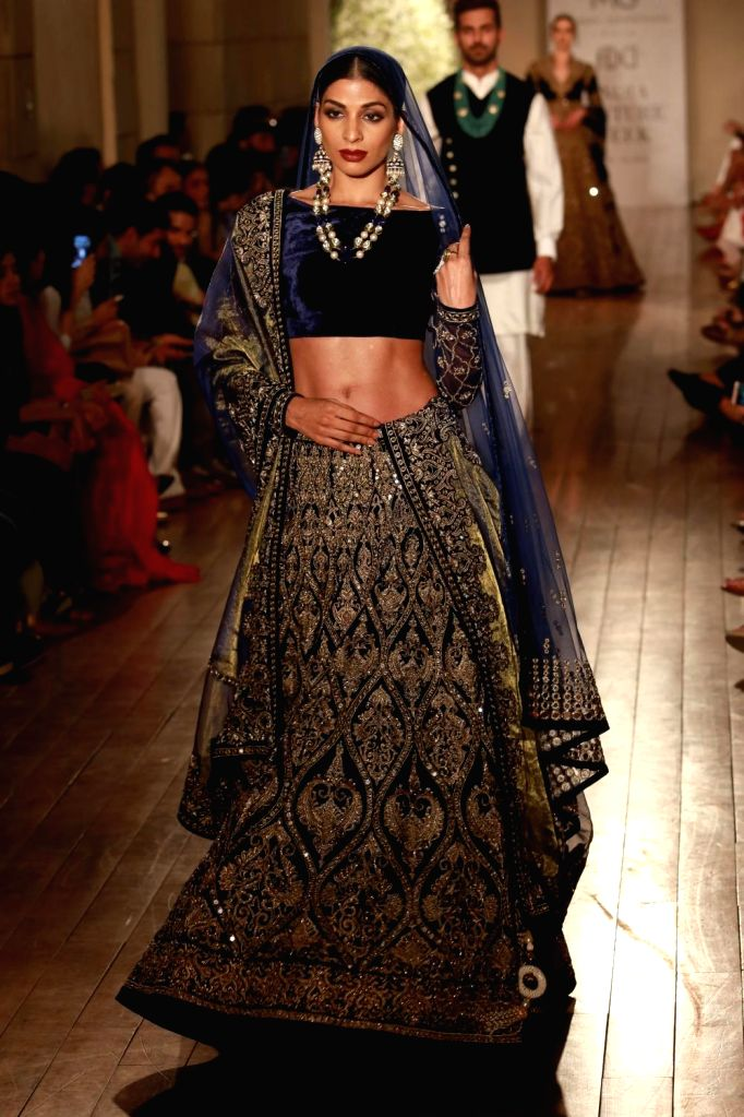 A model walks the ramp during designer Manav Gangwani's show at the India Couture Week 2016, in New Delhi on July 24, 2016.