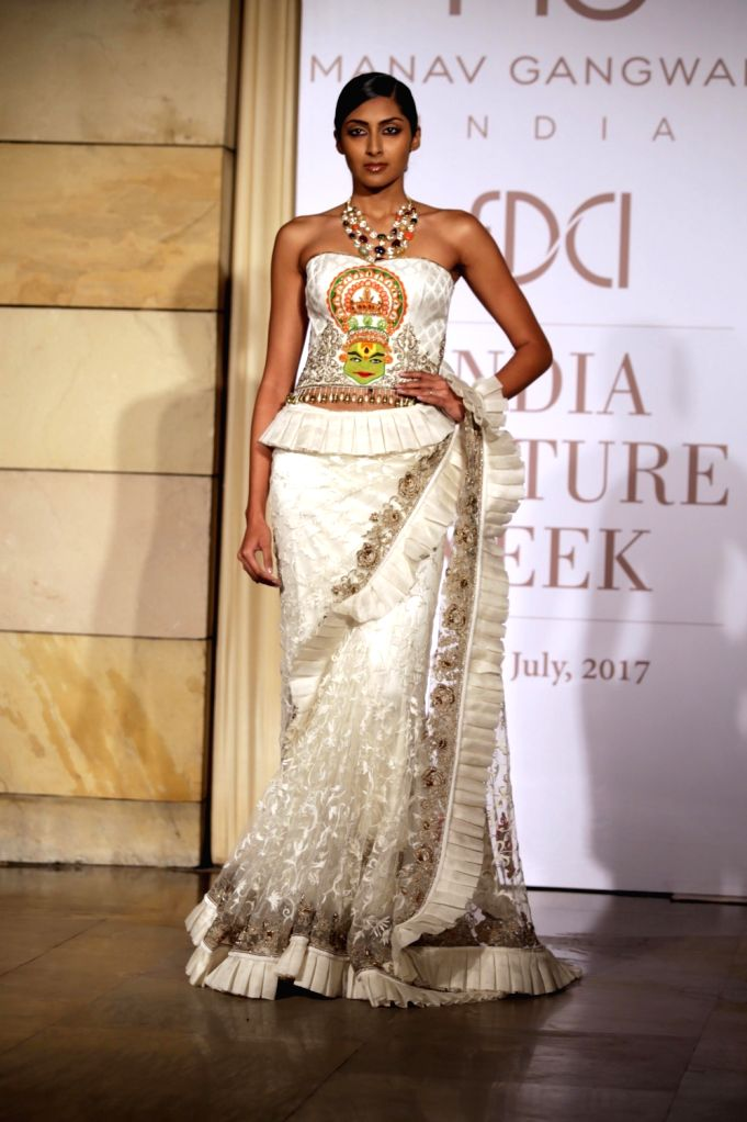 A model walks the ramp during designer Manav Gangwani's show at the India Couture Week 2017, in New Delhi, on July 26, 2017.