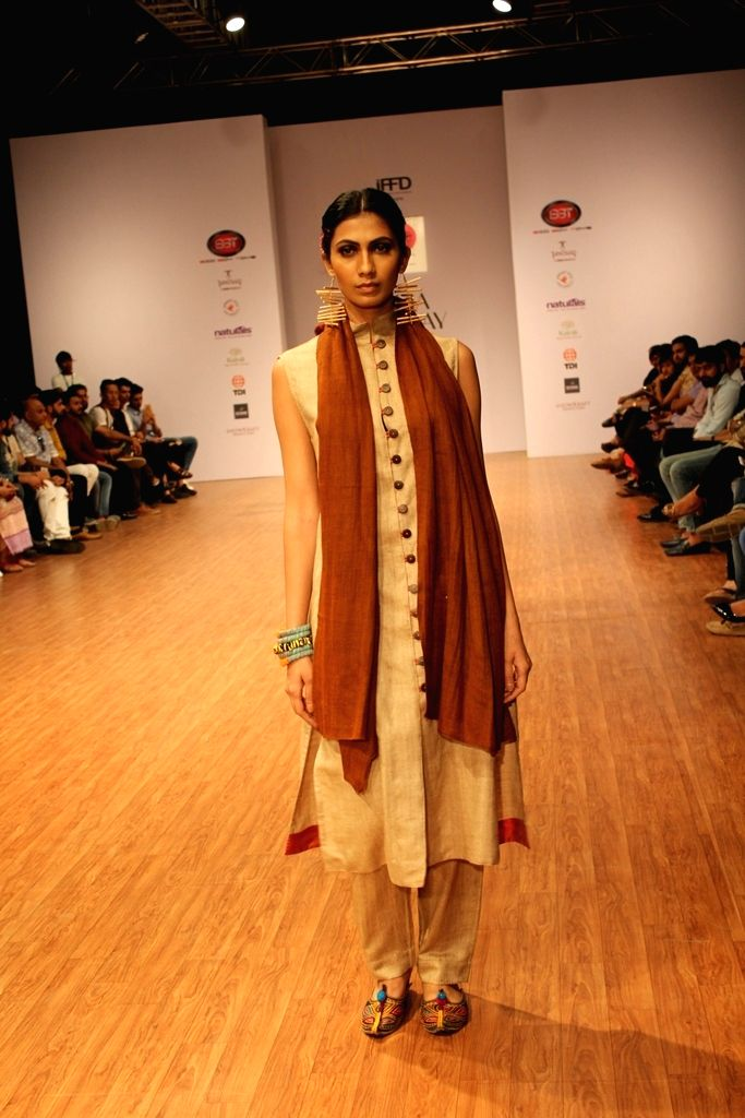 A model walks the ramp during India Runway Week 2016 in New Delhi on Sept 16, 2016.