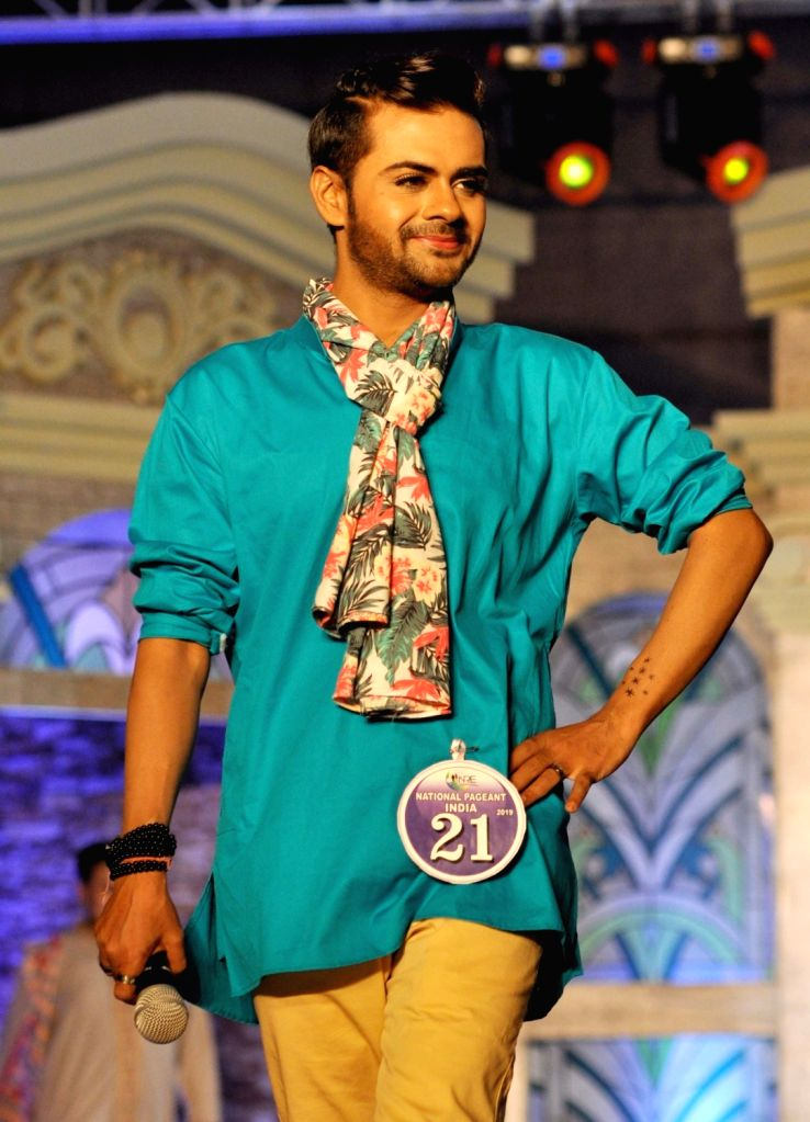 A model walks the ramp during National Pageant India 2019 in Kolkata on July 20, 2019.