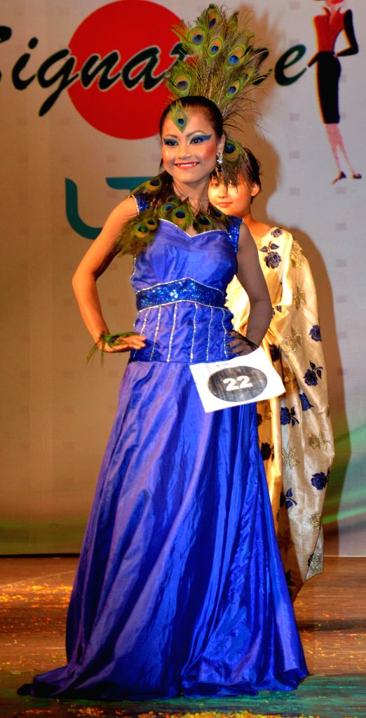 A model walks the ramp during Signature Awards 2014 in Guwahati on Sept 10, 2014.