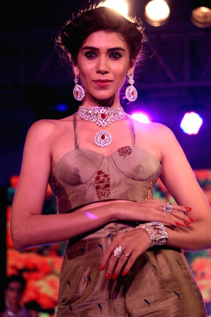 A model walks the ramp during the fashion show at Glamour Exhibition 2016 in Mumbai on Aug 20, 2016.