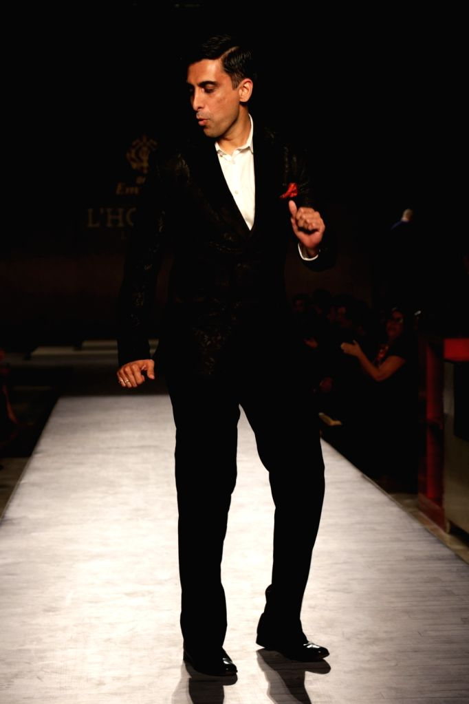 """A model walks the ramp during """"The Men's Fashion show"""" in New Delhi on Feb 16, 2019."""