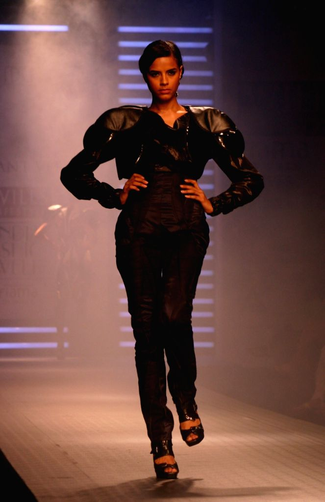 A model walks the ramp for designer Parshant Verma at Wills Lifestyle India Fashion Week in New Delhi on March 19.