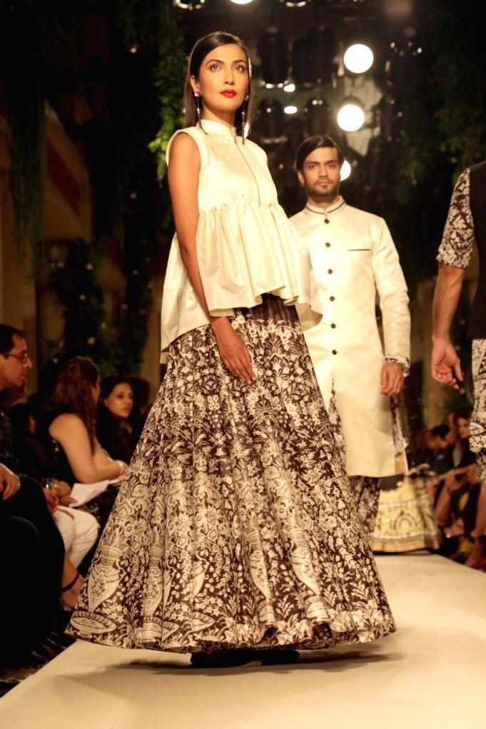 A model walks the ramp for designer Siddhartha Tytler Couture Show in New Delhi on Sept 2, 2017.