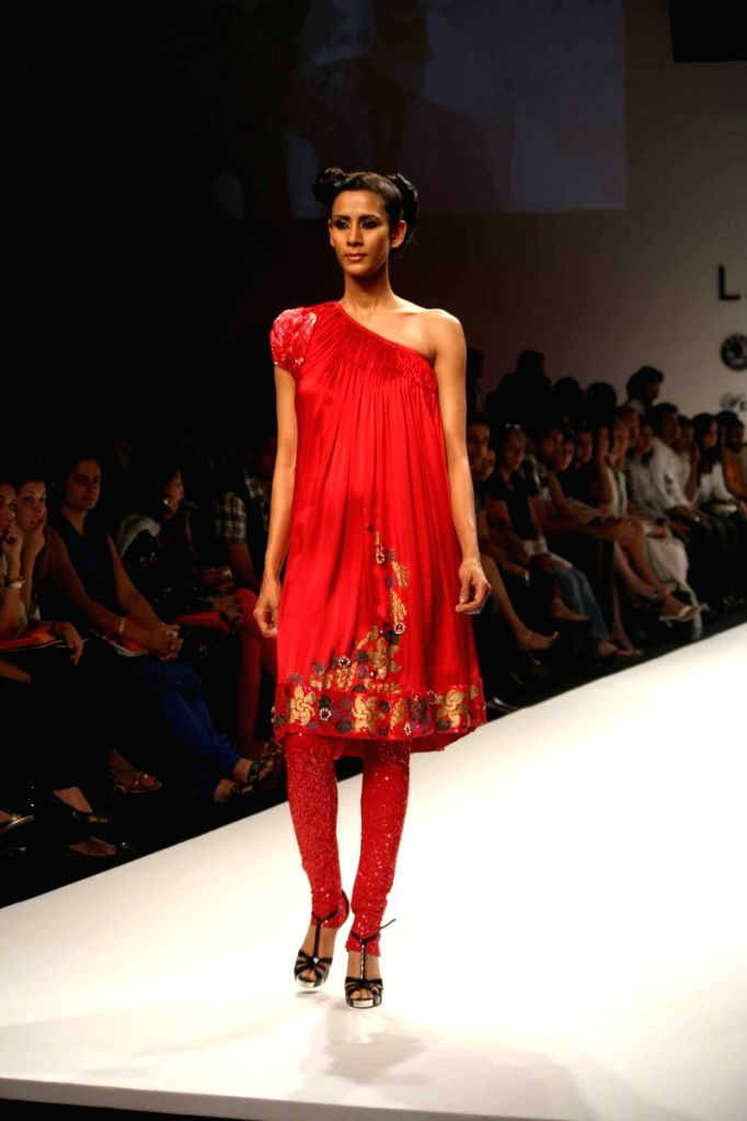 A model walks the ramp for fashion designer Pallavi Jaipur's at the ongoing autumn/winter edition of Lakme India Fashion Week in Mumbai.
