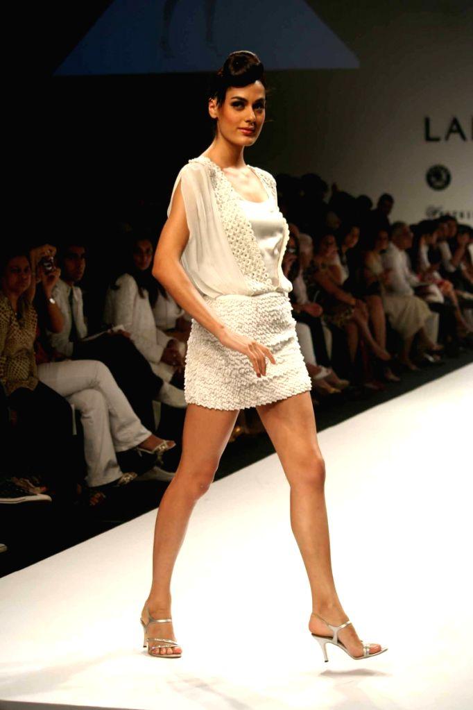 A model walks the ramp for fashion designer Sunaina Puri at the ongoing autumn/winter edition of Lakme India Fashion Week in Mumbai.