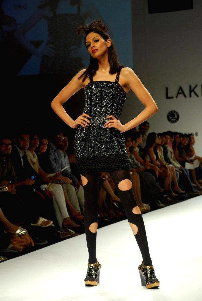 A model walks the ramp for fashion designer Narendra Kumar at the ongoing autumn/winter edition of Lakme India Fashion Week in Mumbai. - Narendra Kumar