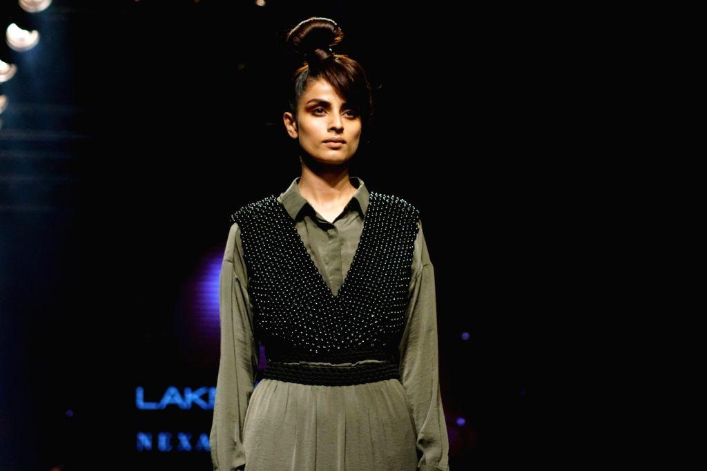 A model walks the ramp for fashion designer Shweta Kapoor during the Lakme Fashion Week 2017 in Mumbai on Aug 16, 2017. - Shweta Kapoor