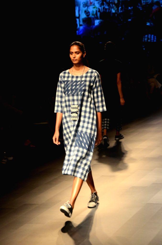 A Model walks the ramp for fashion designer Malu during the Lakme Fashion Week Summer/Resort 2018 in Mumbai on Feb 1, 2018.