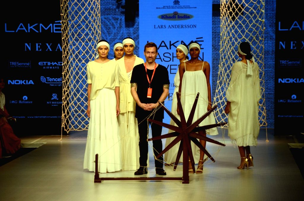 A model walks the ramp for fashion designers Lars Andersson, Buna and Jewellyn Alvares at the Lakme Fashion Week Winter/Festive 2018 in Mumbai on Aug 23, 2018.