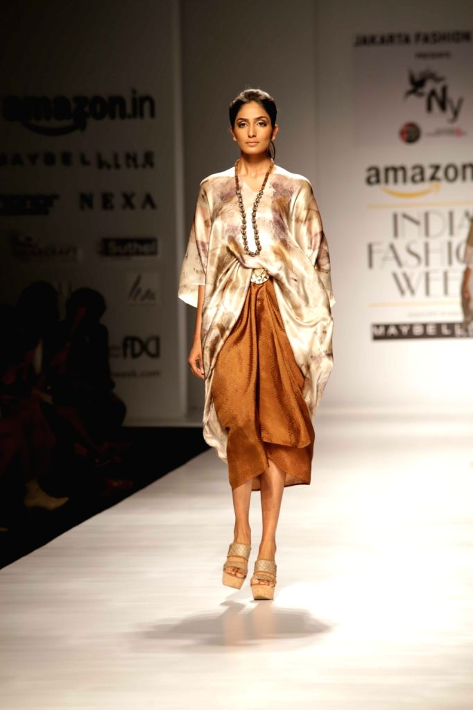 A model walks the ramp for Indonesian fashion designer Novita Yunus during Amazon India Fashion Week - Autumn Winter's, in New Delhi, on March 15, 2017.