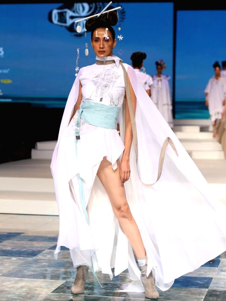 A model walks the ramp Grand finale of Make-up India Fashion Week, in New Delhi on Oct 12, 2019.